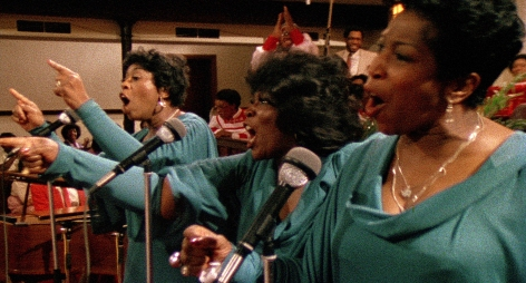 "(From left): Rodessa Barrett Porter, DeLois Barrett Campbell, Billie Barrett GreenBey (The Barrett Sisters) raise the roof performing ""He Has Brought Us"" in SAY AMEN, SOMEBODY, the 1982 classic Gospel documentary directed by George Nierenberg. Film to 4K digital restoration by Metropolis Post, New York: Jack Rizzo, Ian Bostick (restoration artist), Jason Crump (colorist) and Allen Perkins. Audio Restoration and 5.1 Sound by Audio Mechanics. Sound Engineer: John Polito. Restoration Produced by Milestone Film & Video, the Smithsonian National Museum of African American History and Culture and the Academy Film Archive. Funding by Robert F. Smith Fund Professional Curation Project and the Academy Film Archive. Supervised by George Nierenberg and Dennis Doros."