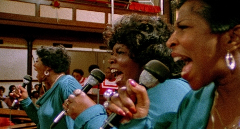 "(From left) Rodessa Barrett Porter, DeLois Barrett Campbell, Billie Barrett GreenBey (The Barrett Sisters) raise the roof, performing the song ""He Has Brought Us"" in SAY AMEN, SOMEBODY, the 1982 classic Gospel documentary directed by George Nierenberg. Film to 4K digital restoration by Metropolis Post, New York: Jack Rizzo, Ian Bostick (restoration artist), Jason Crump (colorist) and Allen Perkins. Audio Restoration and 5.1 Sound by Audio Mechanics. Sound Engineer: John Polito. Restoration Produced by Milestone Film & Video, the Smithsonian National Museum of African American History and Culture and the Academy Film Archive. Funding by Robert F. Smith Fund Professional Curation Project and the Academy Film Archive. Supervised by George Nierenberg and Dennis Doros."